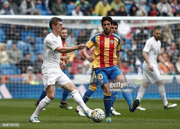Toni Kroos of Real Madrid in action against Dani Parejo of Valencia during the Spanish La Liga match between Real Madrid and Valencia at Santiago...