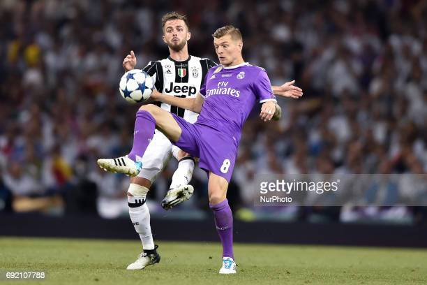 Toni Kroos of Real Madrid is challenged by Miralem Pjanic of Juventus during the UEFA Champions League Final match between Real Madrid and Juventus...
