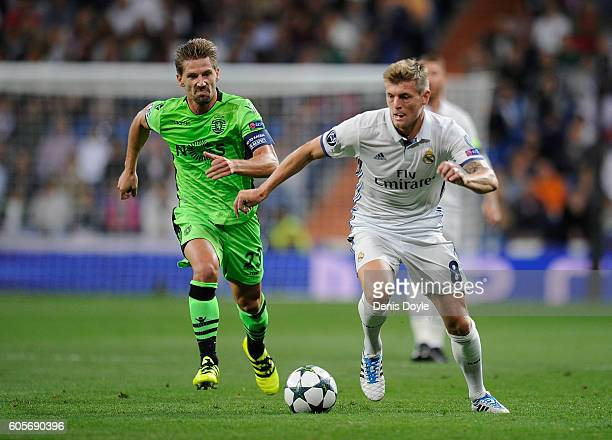 Toni Kroos of Real Madrid is chased by Adrien Silva of Sporting Clube de Portugal during the UEFA Champions League Group F match between Real Madrid...