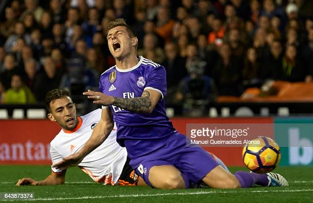 Toni Kroos of Real Madrid is tackled by Munir El Haddadi of Valencia during the La Liga match between Valencia CF and Real Madrid at Mestalla Stadium...