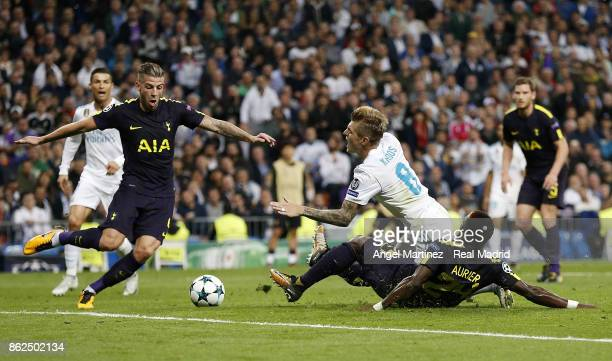 Toni Kroos of Real Madrid is tackled in penalty area by Serge Aurier of Tottenham Hotspur during the UEFA Champions League group H match between Real...