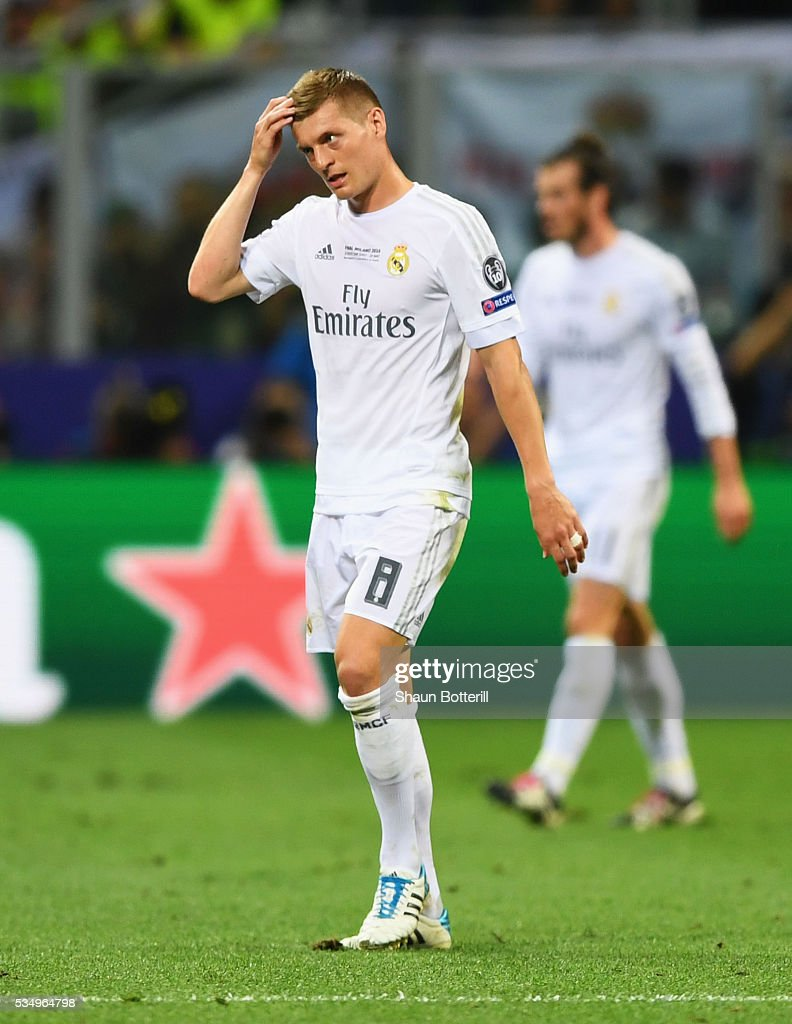<a gi-track='captionPersonalityLinkClicked' href=/galleries/search?phrase=Toni+Kroos&family=editorial&specificpeople=638597 ng-click='$event.stopPropagation()'>Toni Kroos</a> of Real Madrid leaves the pitch after being substituted during the UEFA Champions League Final match between Real Madrid and Club Atletico de Madrid at Stadio Giuseppe Meazza on May 28, 2016 in Milan, Italy.