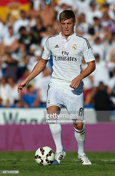 Toni Kroos of Real Madrid runs with the ball during the La Liga match between Levante UD and Real Madrid at Ciutat de Valencia on October 18 2014 in...