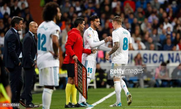 Toni Kroos of Real Madrid shakes hands with Theo Hernandez of Real Madrid during the La Liga match between Real Madrid and Malaga at Estadio Santiago...