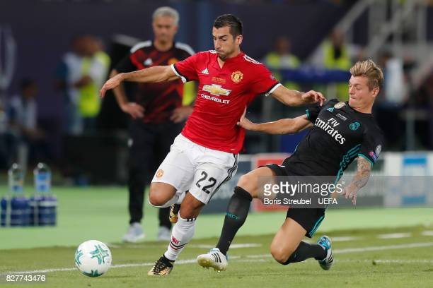 Toni Kroos of Real Madrid tackles Henrikh Mkhitaryan of Manchester United during the UEFA Super Cup final between Real Madrid and Manchester United...