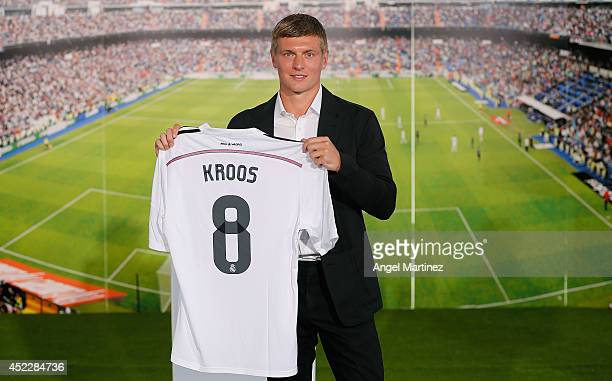 Toni Kroos poses during his official unveiling as a new Real Madrid player at Estadio Santiago Bernabeu on July 17 2014 in Madrid Spain