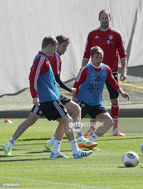 Toni Kroos Thomas Mueller Mario Goetze and Tom Starke of Bayern Muenchen warm up during a training session at the Bayern Muenchen training gound on...