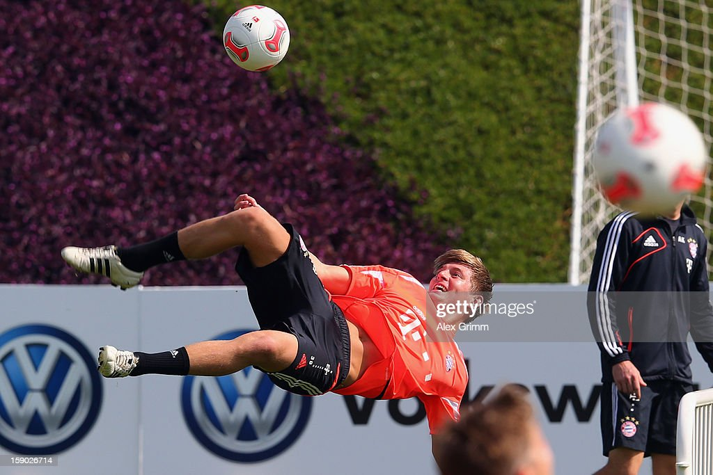 Toni Kroos tries a bicycle-kick during a Bayern Muenchen training session at the ASPIRE Academy for Sports Excellence on January 6, 2013 in Doha, Qatar.