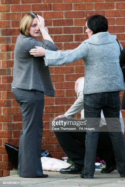 Toni Lappin and John Lappin with a mourner at the scene where their son Joseph Lappin was stabbed to death outside a youth club in Everton on Monday...