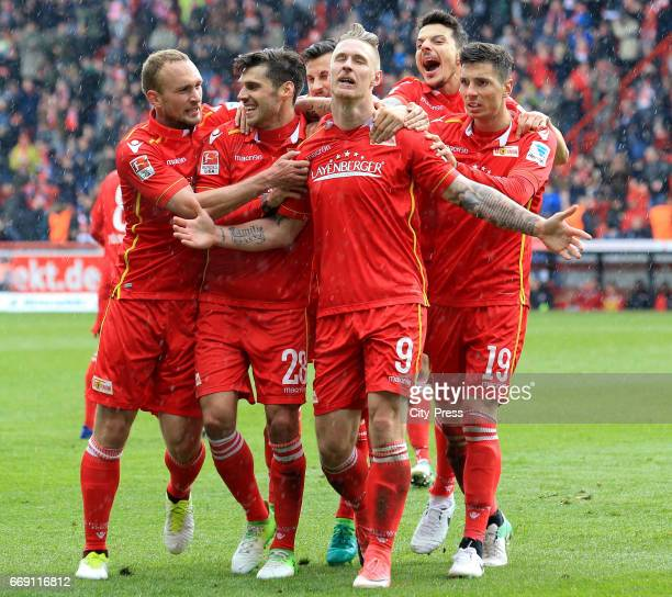 Toni Leistner Christopher Trimmel Sebastian Polter Philipp Hosiner and Damir Kreilach of 1 FC Union Berlin celebrate after scoring the 21 during the...