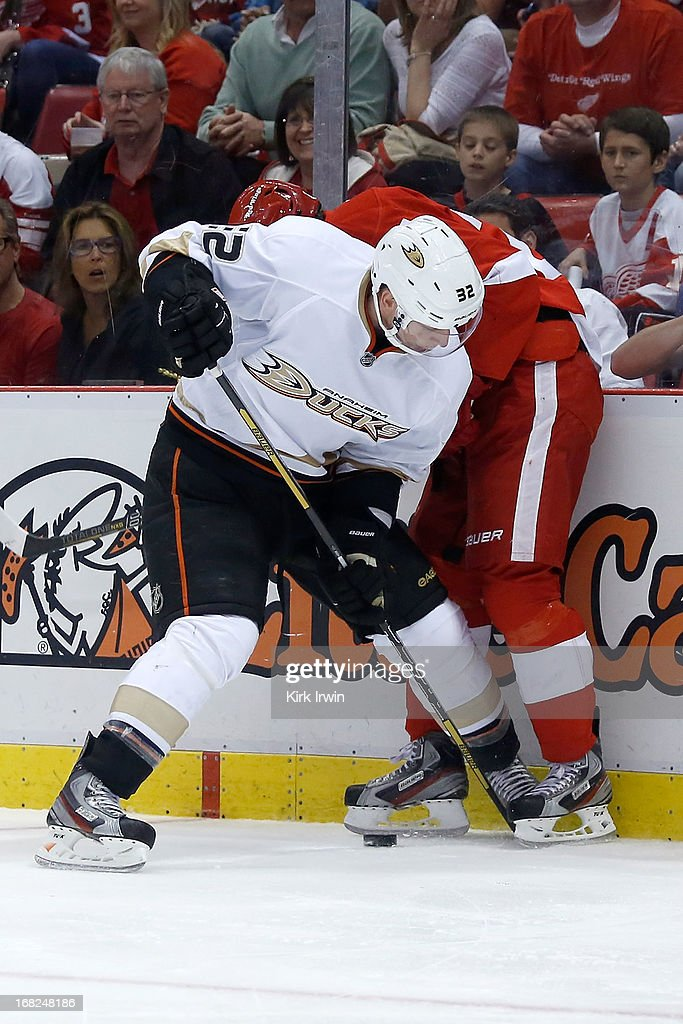 Toni Lydman #32 of the Anaheim Ducks battles for control of the puck with Damien Brunner #24 of the Detroit Red Wings during Game Three of the Western Conference Quarterfinals during the 2013 NHL Stanley Cup Playoffs on May 4, 2013 at Joe Lewis Arena in Detroit, Michigan.