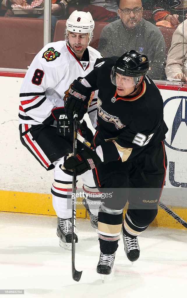 Toni Lydman #32 of the Anaheim Ducks battles for position against Nick Leddy #8 of the Chicago Blackhawks on March 20, 2013 at Honda Center in Anaheim, California.