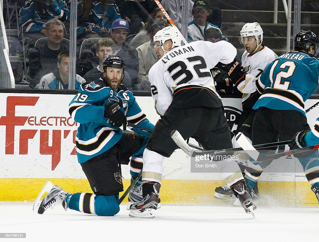 <a gi-track='captionPersonalityLinkClicked' href=/galleries/search?phrase=Toni+Lydman&family=editorial&specificpeople=204145 ng-click='$event.stopPropagation()'>Toni Lydman</a> #32 of the Anaheim Ducks fights for the puck against <a gi-track='captionPersonalityLinkClicked' href=/galleries/search?phrase=Joe+Thornton&family=editorial&specificpeople=201829 ng-click='$event.stopPropagation()'>Joe Thornton</a> #19 of the San Jose Sharks during an NHL game on March 27, 2013 at HP Pavilion in San Jose, California.
