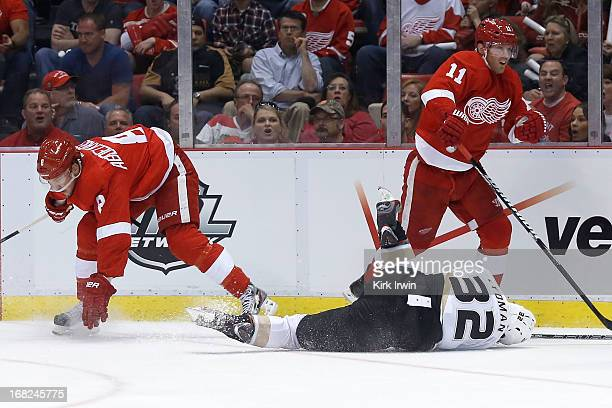 Toni Lydman of the Anaheim Ducks lies on the ice after being checked by Justin Abdelkader of the Detroit Red Wings during Game Three of the Western...