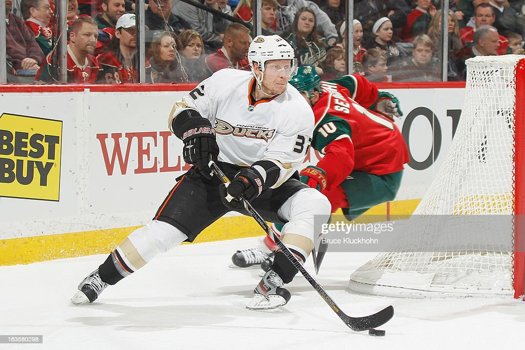 <a gi-track='captionPersonalityLinkClicked' href=/galleries/search?phrase=Toni+Lydman&family=editorial&specificpeople=204145 ng-click='$event.stopPropagation()'>Toni Lydman</a> #32 of the Anaheim Ducks skates with the puck while <a gi-track='captionPersonalityLinkClicked' href=/galleries/search?phrase=Devin+Setoguchi&family=editorial&specificpeople=2221039 ng-click='$event.stopPropagation()'>Devin Setoguchi</a> #10 of the Minnesota Wild defends during the game on March 12, 2013 at the Xcel Energy Center in Saint Paul, Minnesota.