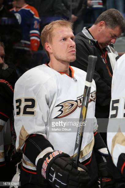 Toni Lydman of the Anaheim Ducks stands for the singing of the national anthem prior to a game against the Edmonton Oilers on April 21 2013 at Rexall...