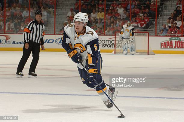 Toni Lydman of the Buffalo Sabres skates with the puck during a NHL preseason hockey game game against the Washington Capitals on Sptember 21 2009 at...
