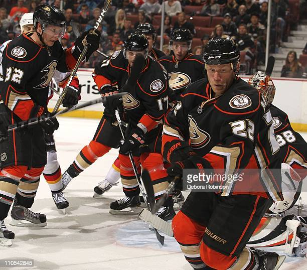 Toni Lydman Todd Marchant and Lubomir Visnovsky of the Anaheim Ducks defend outside the net against the Calgary Flames during the game at Honda...
