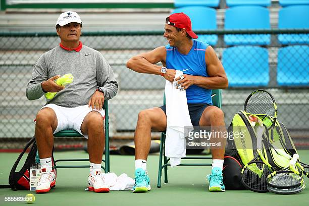 Toni Nadal and Rafael Nadal of Spain chat during a practice session ahead of the Rio 2016 Olympic Games at the Olympic Tennis Centre on August 3 2016...