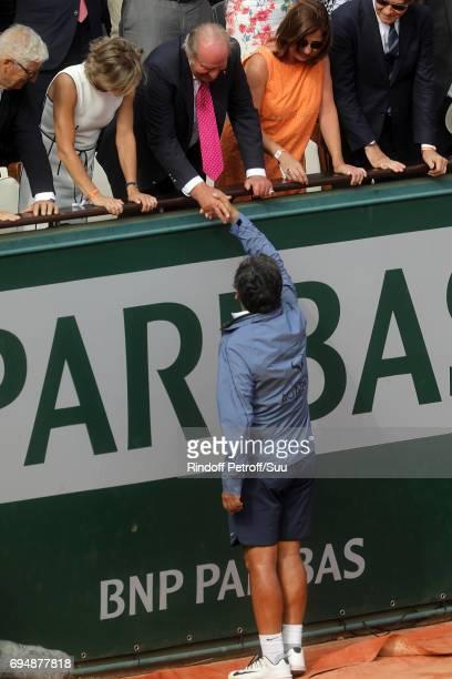 Toni Nadal greets Juan Carlos of spain during the mens singles final match between Rafael Nadal of Spain and Stan Wawrinka of Switzerland on day...