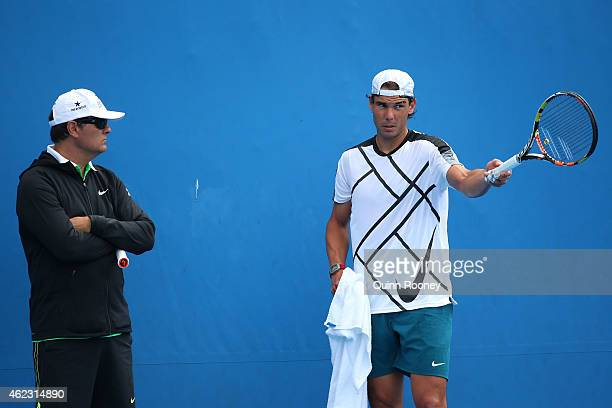 Toni Nadal watches Rafael Nadal of Spain in a practice session during day nine of the 2015 Australian Open at Melbourne Park on January 27 2015 in...