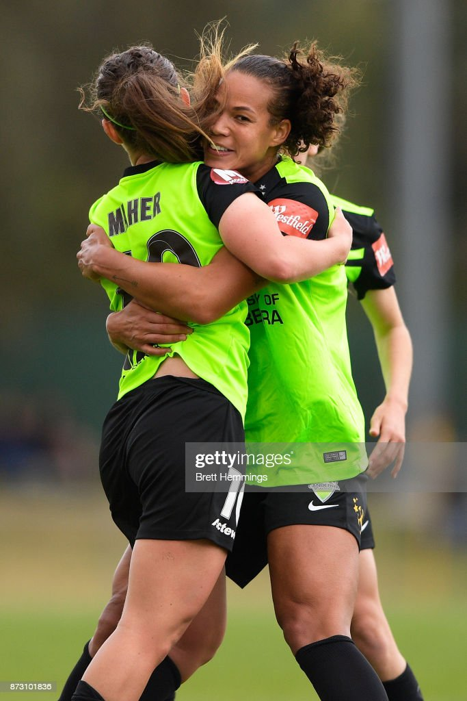 Toni Pressley of Canberra celebrates scoring a goal with team mates during the round three W-League match between Canberra United and Sydney FC at McKellar Park on November 12, 2017 in Canberra, Australia.