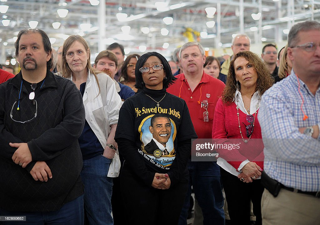 Toni Price, team leader of the 8-speed transmission assembly line, center, wears a tee shirt with a likeness of Barack Obama as she stands with fellow employees while listening to Sergio Marchionne, chief executive officer of Chrysler Group LLC and Fiat SpA, unseen, speak at the Chrysler Group transmission plant in Kokomo, Indiana, U.S., on Thursday, Feb. 28, 2013. Chrysler Group LLC, the automaker majority owned by Fiat SpA, will invest about $374 million and add 1,250 jobs at Indiana factories to boost output of eight-and nine-speed transmissions. Photographer: Daniel Acker/Bloomberg via Getty Images
