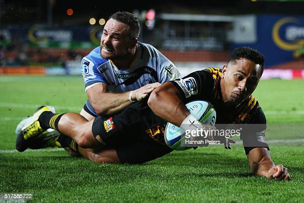 Toni Pulu of the Chiefs dives over to score a try during the round five Super Rugby match between the Chiefs and the Western Force at FMG Stadium on...