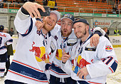 Toni Soederholm Maximilian Kastner and Keith Aucoin of EHC Red Bull Muenchen after the game between the Grizzlys Wolfsburg and dem EHC Red Bull...