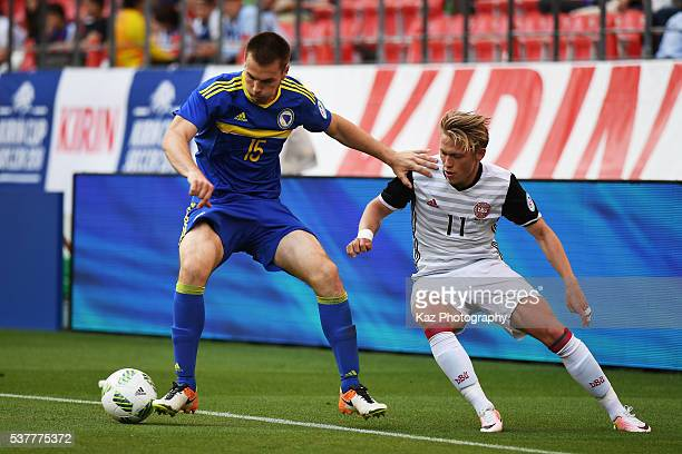 Toni Sunjic of Bosnia and Herzegovina and Viktor Fischer of Denmark compete for the ball during the international friendly match between Bosnia and...
