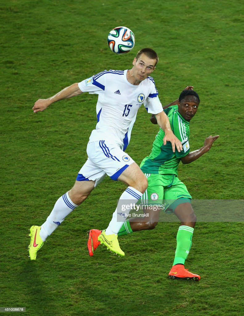 Toni Sunjic of Bosnia and Herzegovina controls the ball against Ahmed Musa of Nigeria during the 2014 FIFA World Cup Group F match between Nigeria and Bosnia-Herzegovina at Arena Pantanal on June 21, 2014 in Cuiaba, Brazil.