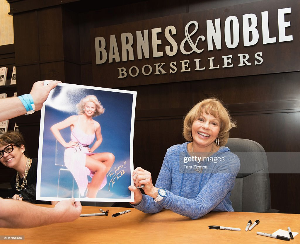 Toni Tennille autographs a poster at Barnes & Noble at The Grove on April 30, 2016 in Los Angeles, California.