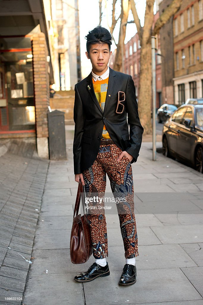 Toni Tran stylist and blogger wearing Zara shoes, Fashitects glasses, Dent de Man trousers, Trine Lindegaard sweater, Dolce and Gabbana shirt, Top Man blazer and a debenhams bag on day 3 of London Mens Fashion Week Autumn/Winter 2013, on January 09, 2013 in London, England.