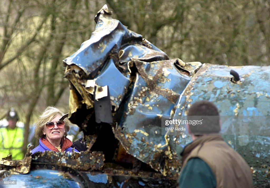 Tonia Bern-Campbell, left, the widow of former world water speed record holder Donald Campbell, inspects the wreckage of her late husband's speedboat 'Bluebird,' March 8, 2001 at Coniston Water in the Lake District of England. The craft was raised from the lake bed 34 years after its pilot Donald Campbell crashed the jet-powered boat while attempting to break his own world water speed record. Campbell was killed in the attempt.