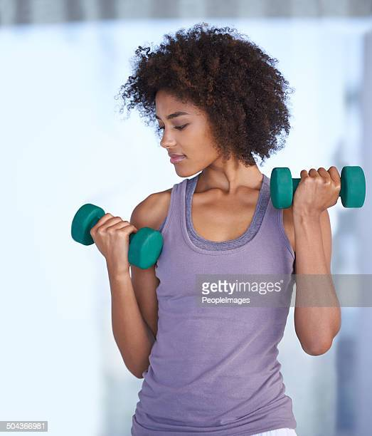 Toning her biceps