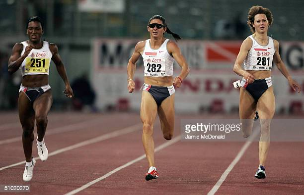 Tonique Williams of Bahamas beats Ana Guuevara of Mexico to the line during the womens 400m at the IAAF Golden Gala meet at the Olympic stadium on...