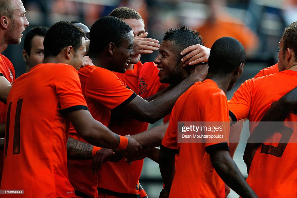 Tonny Trindade de Vilhena (C) of Netherlands celebrates scoring the first goal of the game with team mates during the 2015 UEFA European U21 Championships Qualifier between Netherlands U21s and Scotland U21s held at De Goffert Stadion on September 5, 2013 in Nijmegen, Netherlands.