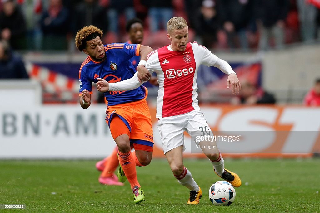 Tonny Vilhena of Feyenoord, Donny van der Beek of Ajax during the Dutch Eredivisie match between Ajax Amsterdam and Feyenoord Rotterdam at the Amsterdam Arena on February 07, 2016 in Amsterdam, The Netherlands