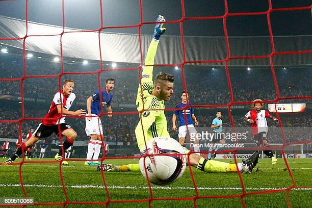 Tonny Vilhena of Feyenoord scores his sides first goal past goalkeeper David De Gea of Manchester United during the UEFA Europa League Group A match...