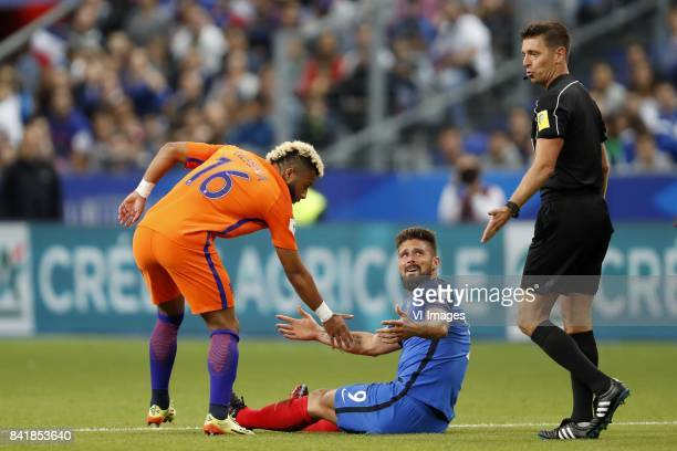 Tonny Vilhena of Holland Olivier Giroud of France referee Gianluca Rocchi during the FIFA World Cup 2018 qualifying match between France and...