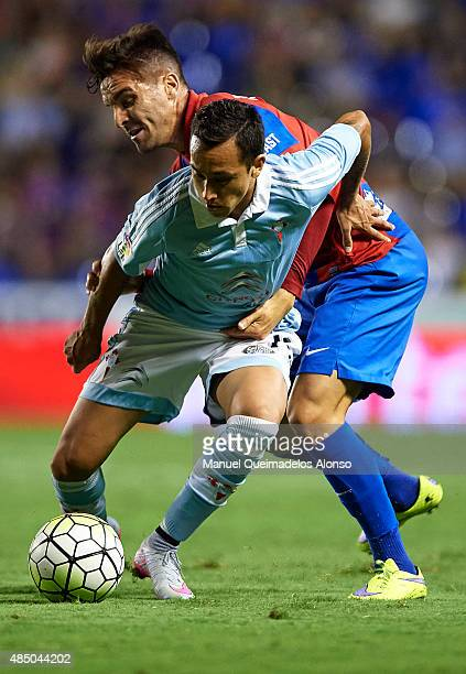Tono Garcia of Levante battle for the ball with Fabian Orellana of Celta during the La Liga match between Levante UD and Real Club Celta de Vigo at...