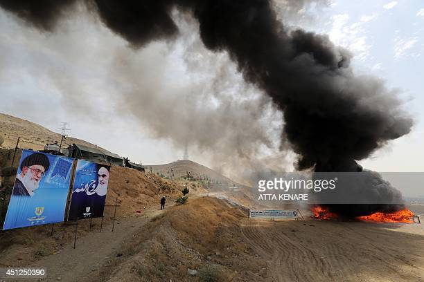 50 tons of drugs seized in recent months burn next to portraits of Iran's supreme leader Ayatollah Ali Khamenei and Iran's founder of the Islamic...