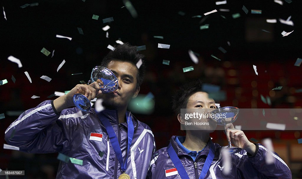 Tontowi Ahmad and <a gi-track='captionPersonalityLinkClicked' href=/galleries/search?phrase=Liliyana&family=editorial&specificpeople=4055313 ng-click='$event.stopPropagation()'>Liliyana</a> Natsir of Indonesia celebrate with their trophy's after defeating Zhang Nan and Zhao Yunlei of China in the final of the mixed doubles during Day 6 of the Yonex All England Badminton Open at NIA Arena on March 10, 2013 in Birmingham, England.