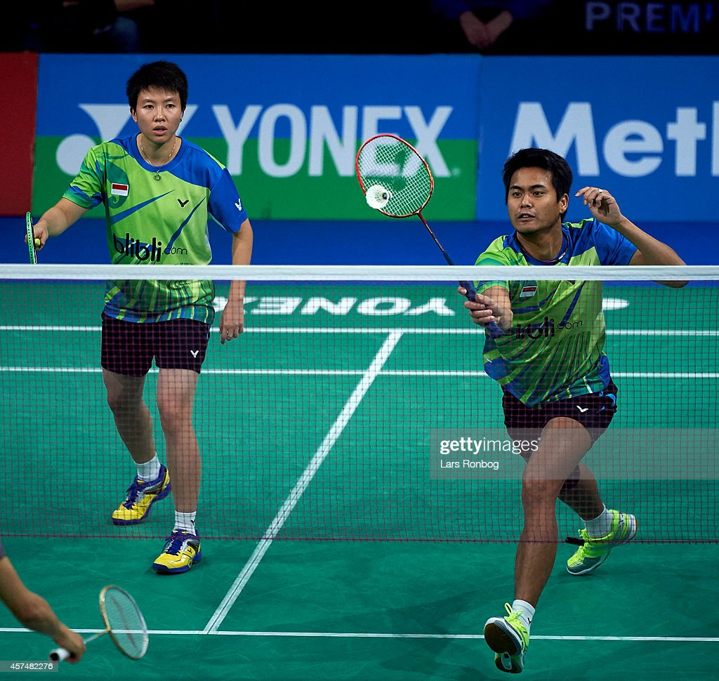 Tontowi Ahmad and <a gi-track='captionPersonalityLinkClicked' href=/galleries/search?phrase=Liliyana&family=editorial&specificpeople=4055313 ng-click='$event.stopPropagation()'>Liliyana</a> Natsir of Indonesia in action in the Mixed Double final during the Yonex Denmark Open MetLife BWF World Superseries at Odense Idratspark on October 19, 2014 in Odense, Denmark.
