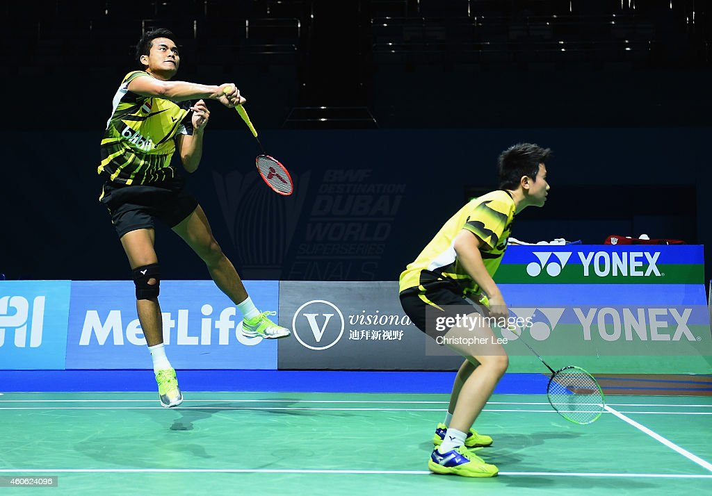 Tontowi Ahmed (L) and <a gi-track='captionPersonalityLinkClicked' href=/galleries/search?phrase=Liliyana&family=editorial&specificpeople=4055313 ng-click='$event.stopPropagation()'>Liliyana</a> Natsir of Indonesia in action against Joachim Fischer Nielsen and Christinna Pedersen of Denmark in action against in the Mixed Doubles during day two of the BWF Destination Dubai World Superseries Finals on December 18, 2014 in Dubai, United Arab Emirates.