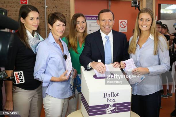Tony Abbott Australia's opposition leader second right poses for a photograph with his wife Margie Abbott second left and their daughters Louise...