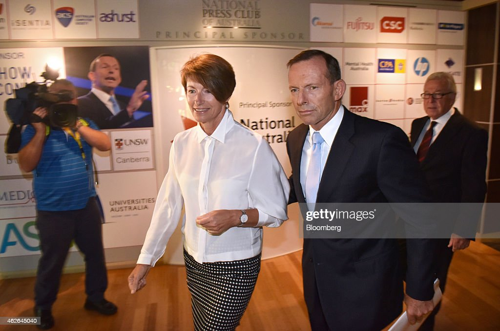 <a gi-track='captionPersonalityLinkClicked' href=/galleries/search?phrase=Tony+Abbott&family=editorial&specificpeople=220956 ng-click='$event.stopPropagation()'>Tony Abbott</a>, Australia's prime minister, second right, arrives with his wife <a gi-track='captionPersonalityLinkClicked' href=/galleries/search?phrase=Margie+Abbott&family=editorial&specificpeople=7149770 ng-click='$event.stopPropagation()'>Margie Abbott</a> before delivering a speech at the National Press Club in Canberra, Australia, on Monday, Feb. 2, 2015. Abbott sought to shore up his position after a state election humbling for allies at the weekend stoked speculation he may face a leadership challenge. Photographer: Mark Graham/Bloomberg via Getty Images