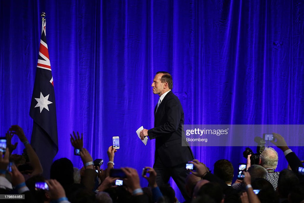 <a gi-track='captionPersonalityLinkClicked' href=/galleries/search?phrase=Tony+Abbott&family=editorial&specificpeople=220956 ng-click='$event.stopPropagation()'>Tony Abbott</a>, Australia's prime minister-elect, arrives on stage to deliver his victory speech at the Liberal-National coalition's election function in Sydney, Australia, on Saturday, Sept. 7, 2013. <a gi-track='captionPersonalityLinkClicked' href=/galleries/search?phrase=Tony+Abbott&family=editorial&specificpeople=220956 ng-click='$event.stopPropagation()'>Tony Abbott</a>'s Liberal-National coalition won Australia's election, consigning Kevin Rudd's Labor party to the shortest stint in power in almost 40 years and ushering in a government pledging to abolish carbon and mining taxes. Photographer: Brendon Thorne/Bloomberg via Getty Images