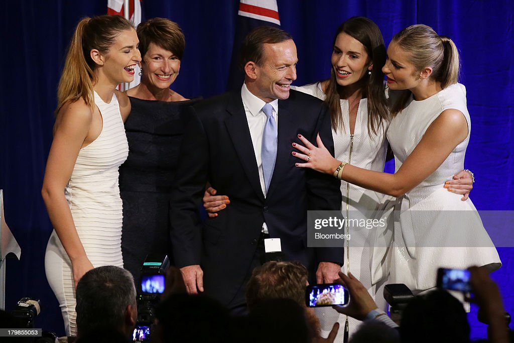 <a gi-track='captionPersonalityLinkClicked' href=/galleries/search?phrase=Tony+Abbott&family=editorial&specificpeople=220956 ng-click='$event.stopPropagation()'>Tony Abbott</a>, Australia's prime minister-elect, center, stands with his wife Margie Abbott, second left, and their daughters Frances Abbott, left, Louise Abbott, second right, and Bridget Abbott after delivering his victory speech at the Liberal-National coalition's election function in Sydney, Australia, on Saturday, Sept. 7, 2013. <a gi-track='captionPersonalityLinkClicked' href=/galleries/search?phrase=Tony+Abbott&family=editorial&specificpeople=220956 ng-click='$event.stopPropagation()'>Tony Abbott</a>'s Liberal-National coalition won Australia's election, consigning Kevin Rudd's Labor party to the shortest stint in power in almost 40 years and ushering in a government pledging to abolish carbon and mining taxes. Photographer: Brendon Thorne/Bloomberg via Getty Images