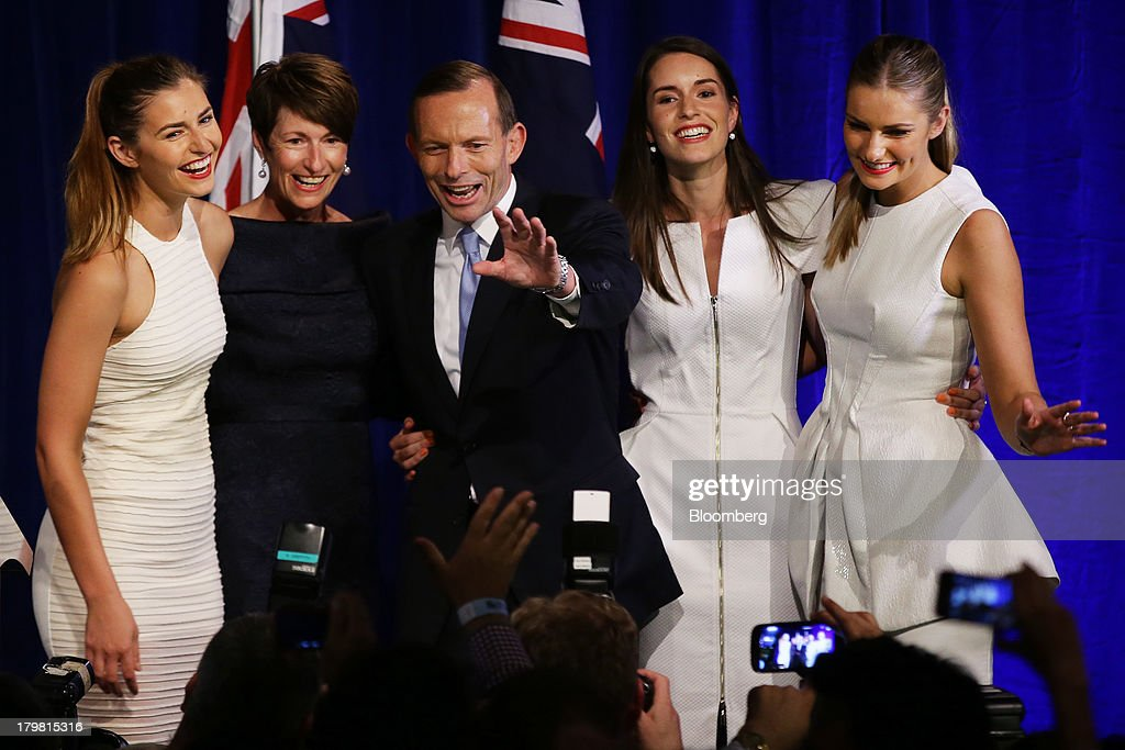 <a gi-track='captionPersonalityLinkClicked' href=/galleries/search?phrase=Tony+Abbott&family=editorial&specificpeople=220956 ng-click='$event.stopPropagation()'>Tony Abbott</a>, Australia's prime minister-elect, center, waves to supporters as he stands with his wife Margie Abbott, second left, and their daughters Frances Abbott, left, Louise Abbott, second right, and Bridget Abbott after delivering his victory speech at the Liberal-National coalition's election function in Sydney, Australia, on Saturday, Sept. 7, 2013. <a gi-track='captionPersonalityLinkClicked' href=/galleries/search?phrase=Tony+Abbott&family=editorial&specificpeople=220956 ng-click='$event.stopPropagation()'>Tony Abbott</a>'s Liberal-National coalition won Australia's election, consigning Kevin Rudd's Labor party to the shortest stint in power in almost 40 years and ushering in a government pledging to abolish carbon and mining taxes. Photographer: Brendon Thorne/Bloomberg via Getty Images